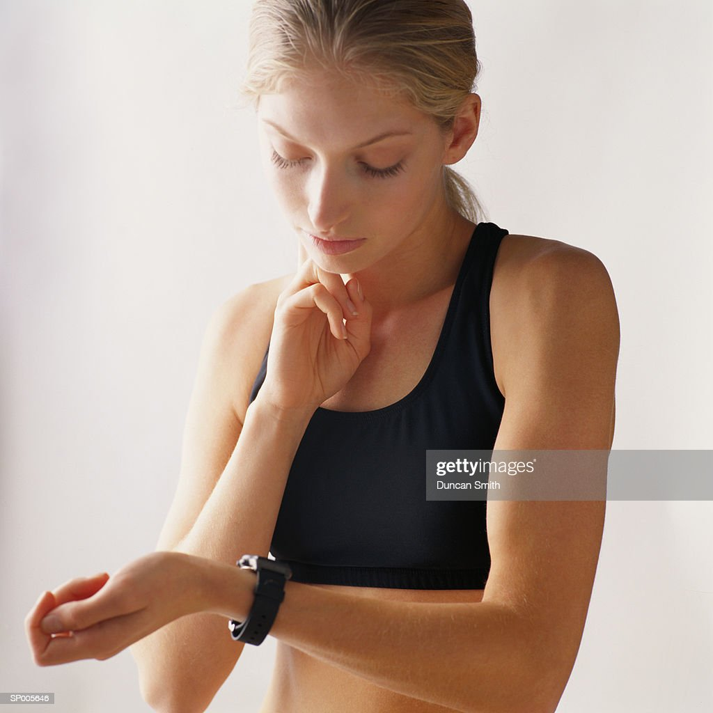 Woman Taking Her Pulse After Exercising : Stock Photo
