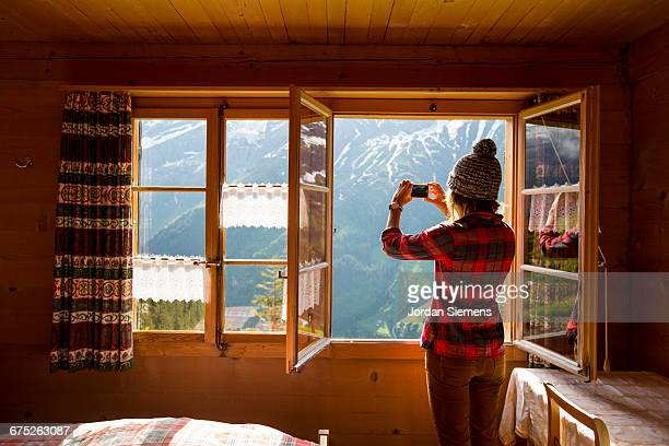 A woman taking in the view form her room