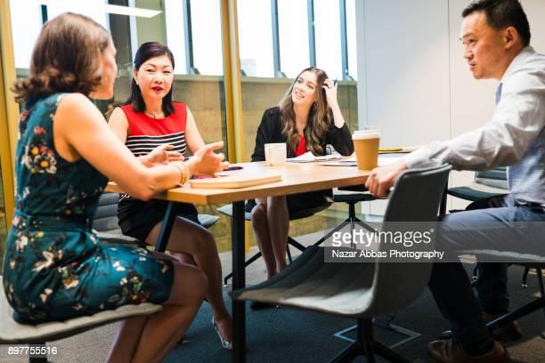 Woman taking lead in meeting.