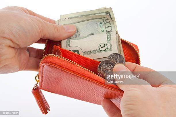 Woman taking money out of a change purse