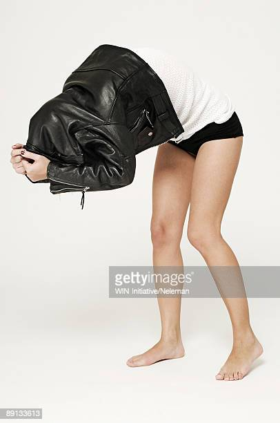 Woman taking off her leather jacket