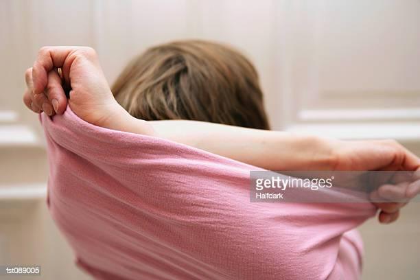 Woman taking off sweater