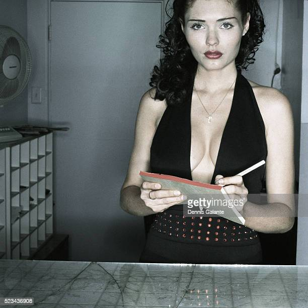 Woman Taking Order Behind Counter