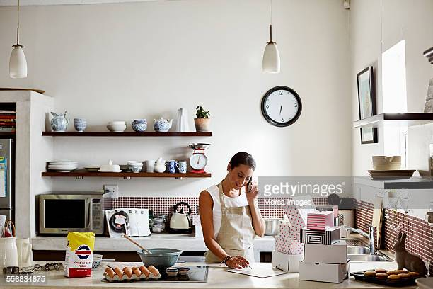woman taking order for cupcakes - box container stock pictures, royalty-free photos & images