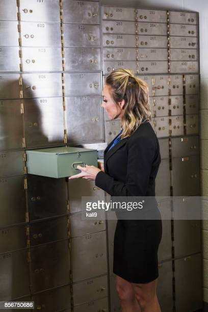 Woman taking out safety deposit box