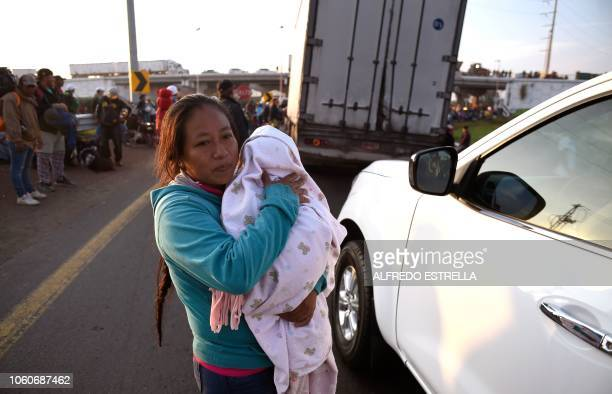 A woman taking part in a caravan of migrants from poor Central American countries mostly Hondurans moving towards the United States in hopes of a...