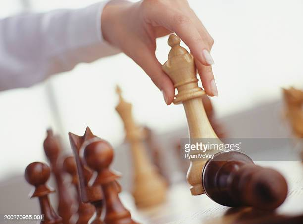 Woman taking pawn with queen, Close-up of hand