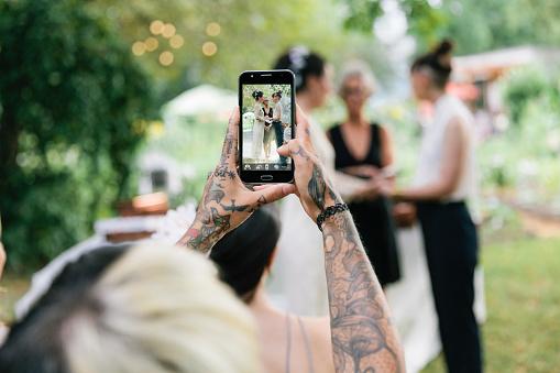 Woman taking photo at Wedding - gettyimageskorea