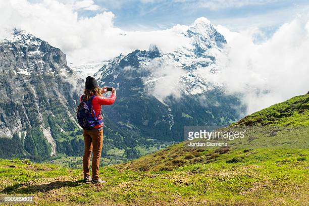 A woman taking photo of Eiger