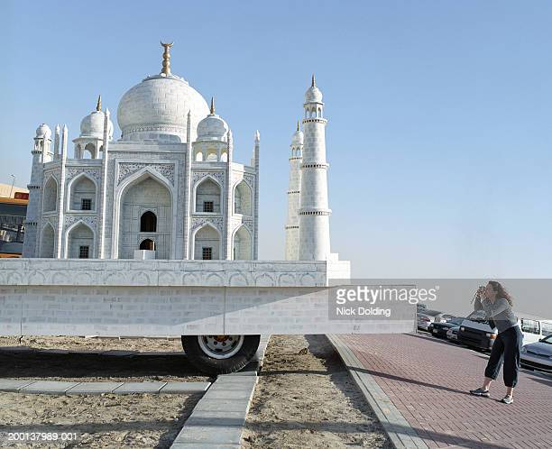 woman taking photo of taj mahal model on back of truck - irony stock pictures, royalty-free photos & images