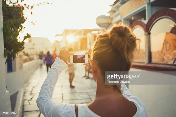 Woman taking photo outdoor