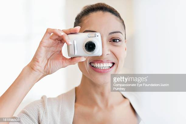 """woman taking photo - """"compassionate eye"""" stock pictures, royalty-free photos & images"""