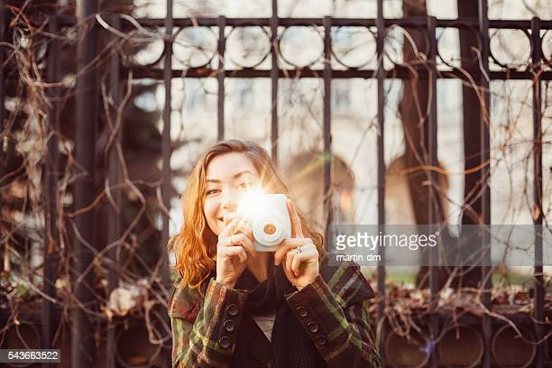 woman taking photo with instant camera - girls flashing camera stock pictures, royalty-free photos & images