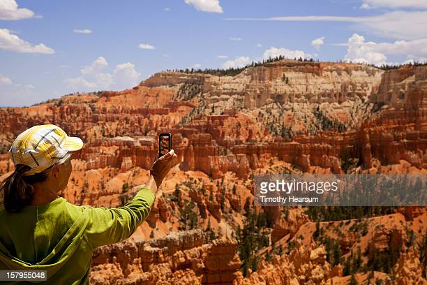 woman taking photo with smart phone - timothy hearsum stock pictures, royalty-free photos & images