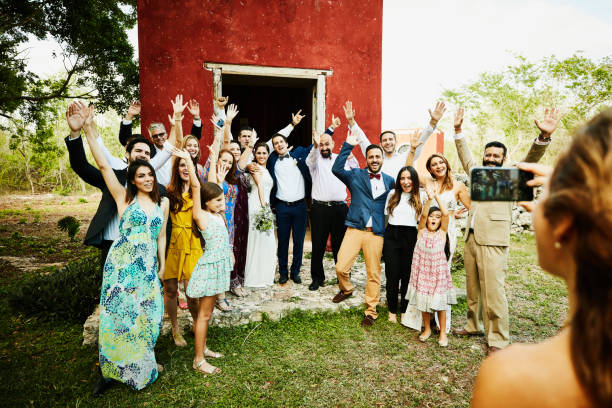 woman taking photo with smartphone of wedding party celebration after ceremony - have fun in wedding stock pictures, royalty-free photos & images