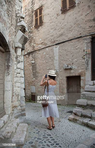 woman taking photograph in old town - サンポールドヴァンス ストックフォトと画像