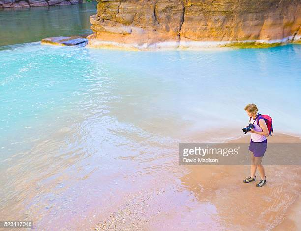 woman taking photographs in grand canyon national park - havasu creek stock photos and pictures