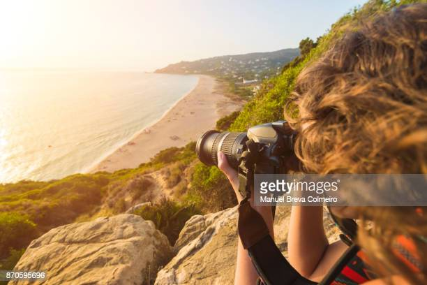 Woman taking photos in Spain