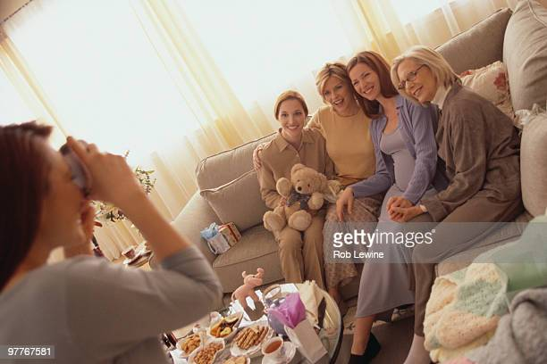 Woman taking picture at baby shower