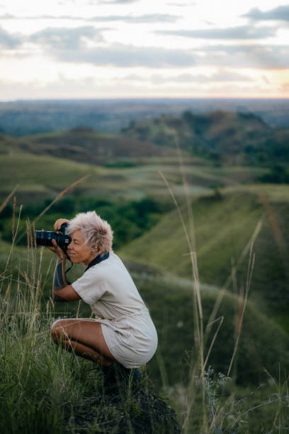Woman Taking Picture In A Field