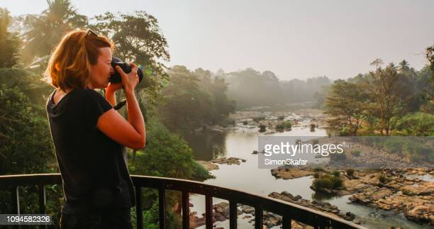 woman taking picture on balcony in sri lanka - sri lanka stock pictures, royalty-free photos & images