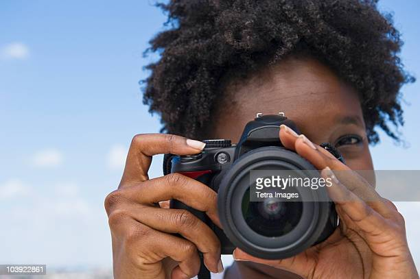 woman taking picture with a digital camera - digital camera stock pictures, royalty-free photos & images