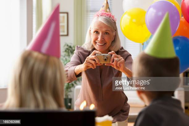 Woman taking pictures at birthday party