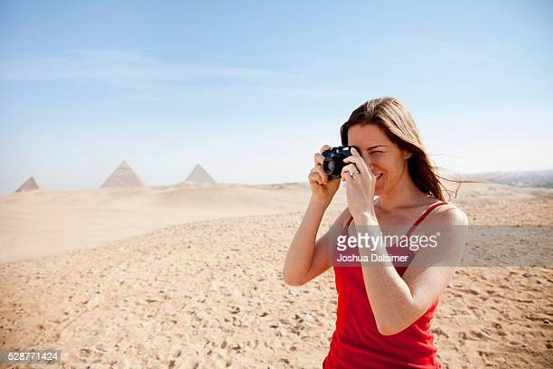 Woman taking pictures in the desert
