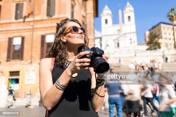 Woman taking pictures on Piazza di Spagna
