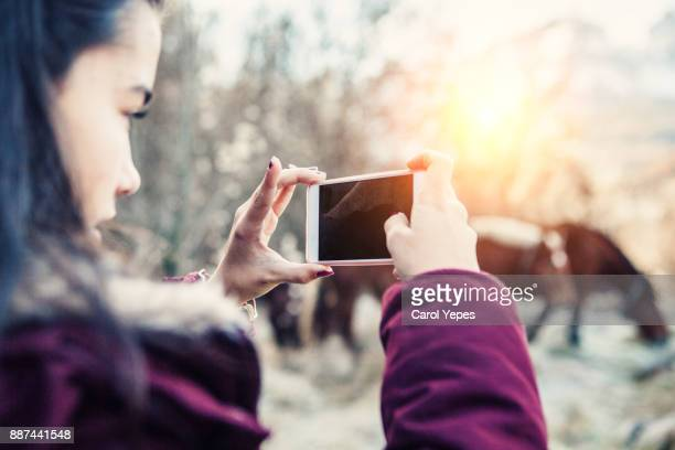 woman taking pictures with smartphone - capturing an image stock pictures, royalty-free photos & images
