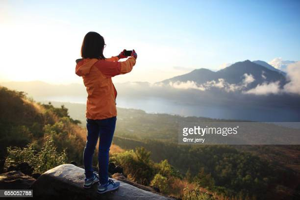 Woman taking picuture outdoors
