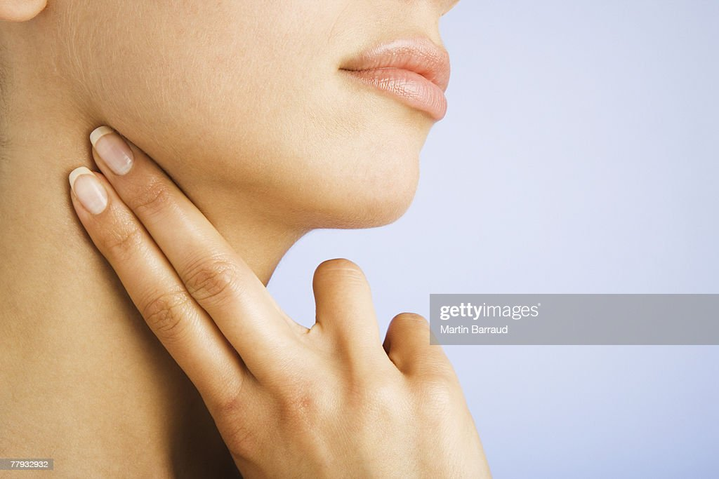 Woman taking pulse : Stock Photo