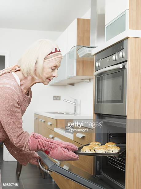 Woman taking scones out of oven