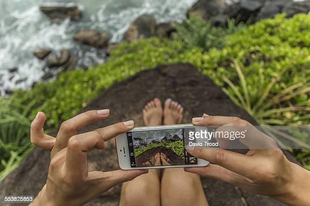 Woman taking selfie of her feet.