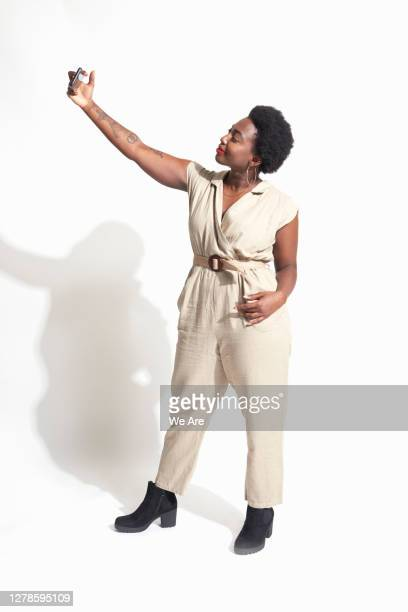 woman taking selfie - full length stock pictures, royalty-free photos & images