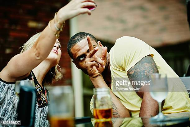 Woman taking selfie with friend at outdoor party