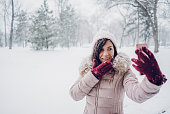 young woman making selfies snow covered