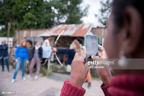 Woman taking smartphone pictures