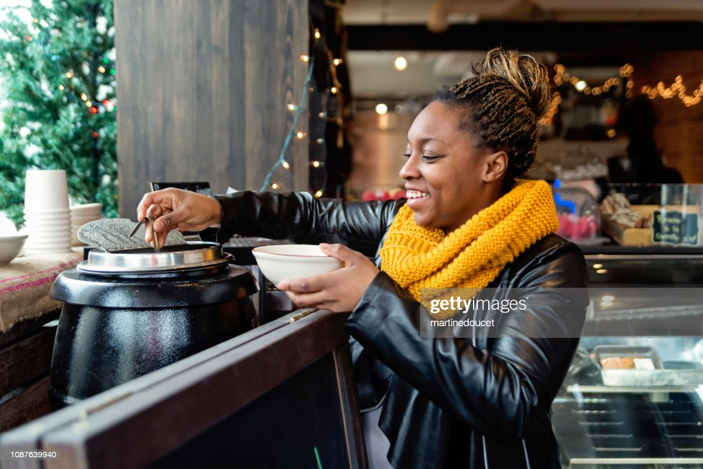 Woman taking soup in self service restaurant in winter. : Stock Photo