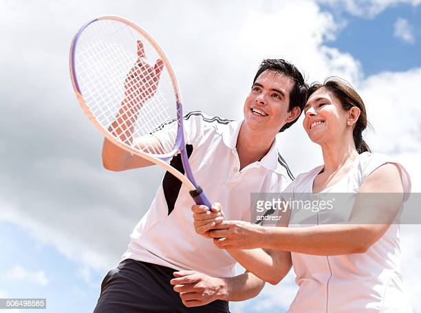 Woman taking tennis lessons