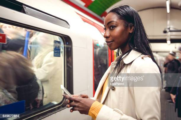 Woman taking the subway train