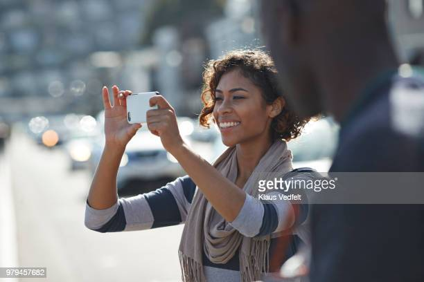 woman taking tourist photo with smartphone - capturing an image stock pictures, royalty-free photos & images