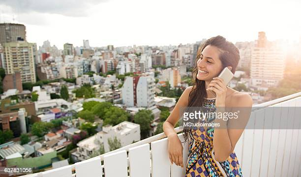 Woman talking at phone.