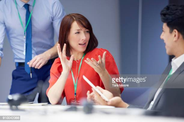 woman talking in business meeting