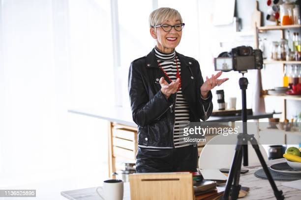 woman talking in front of the camera, recording video for vlog - vlogging stock pictures, royalty-free photos & images