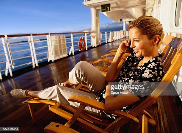 Woman Talking on a Phone on a Cruise Ship Deck
