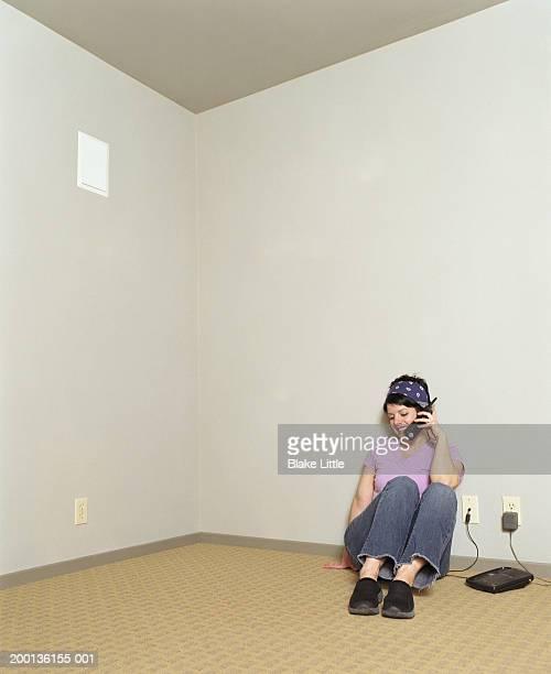 Woman talking on phone in empty room