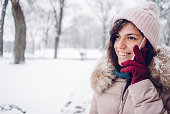 young woman talking over telephone snow