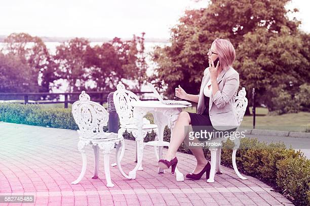 Woman talking on phone outdoors
