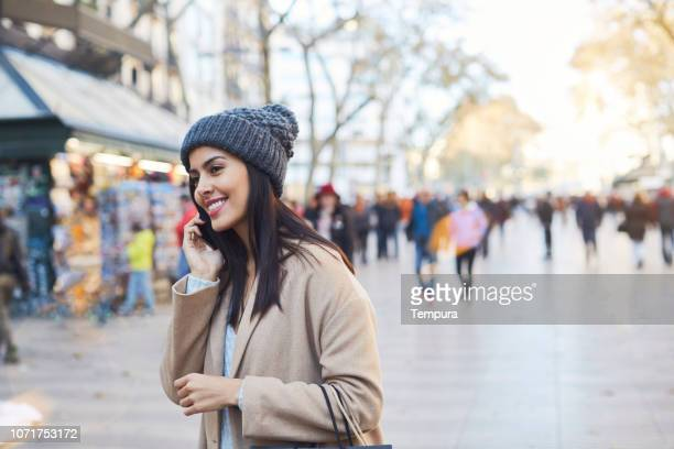 woman talking on the phone in barcelona's las ramblas - the ramblas stock pictures, royalty-free photos & images